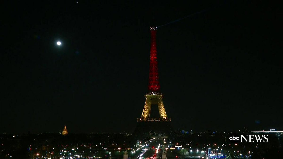 Moon shot: Full moon captured next to Eiffel Tower lit in the colors of the Belgian national flag. #Brussels