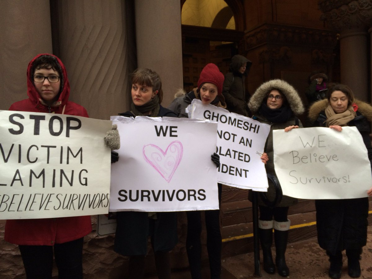#Ghomeshi arrived to court on a miserable cold wet day. These women greeted him https://t.co/YLeS7QKuyx