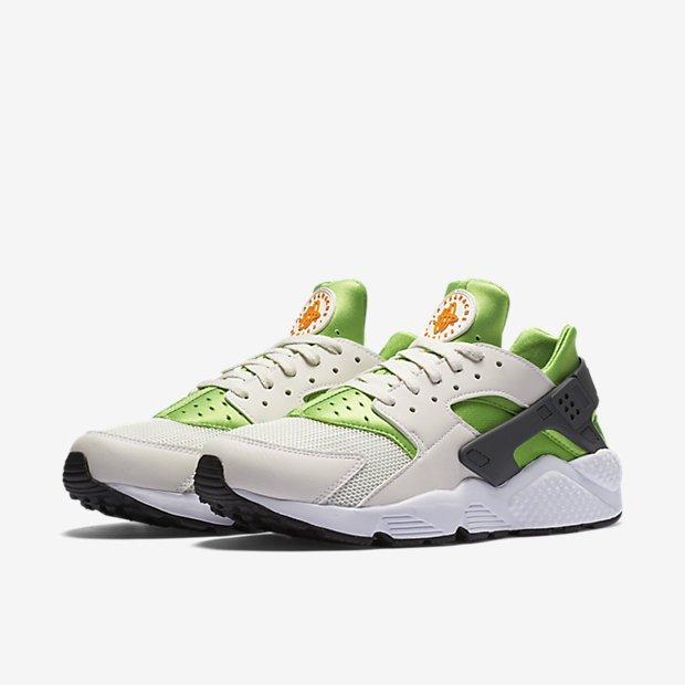 51e2718f3a41 ... Action Green Phantom White Vivid Orange - Men s Nike Air Huarache shoe  in  Never miss a Moment ...