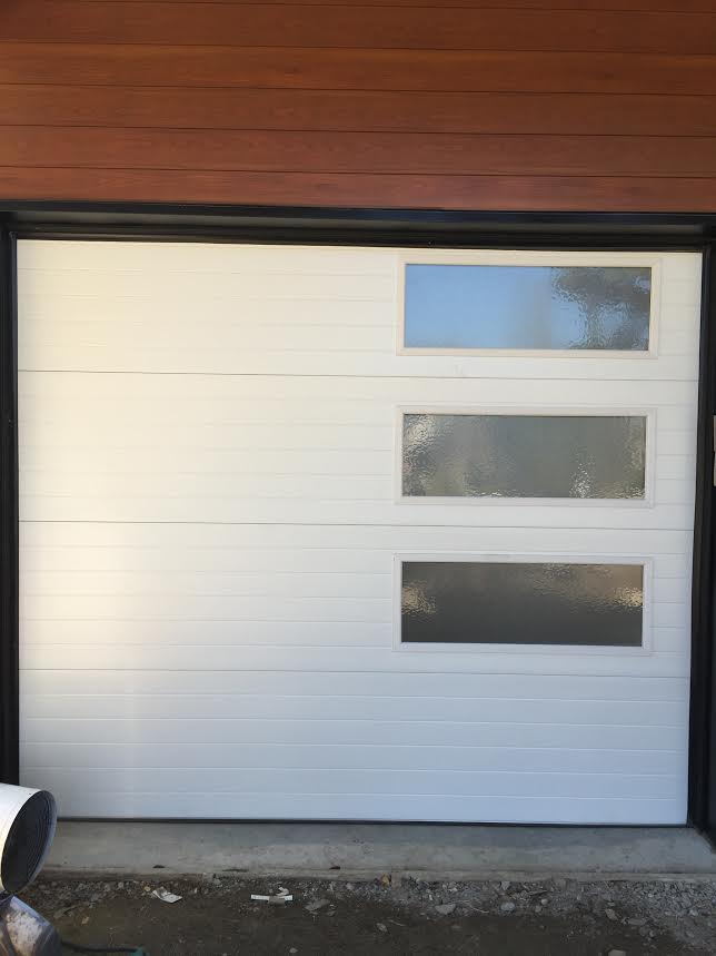 Aurora Overhead Door On Twitter Just Installed This Beautiful Modern Grooved 9205 By Clopay With Windows Down One Side Https T Co Sydf3evbvx