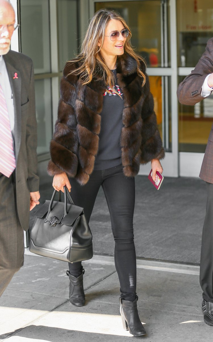 cc90eaccc80 ElizabethHurley was spotted carrying her  Versace Palazzo Empire Bag while  arriving at JFK
