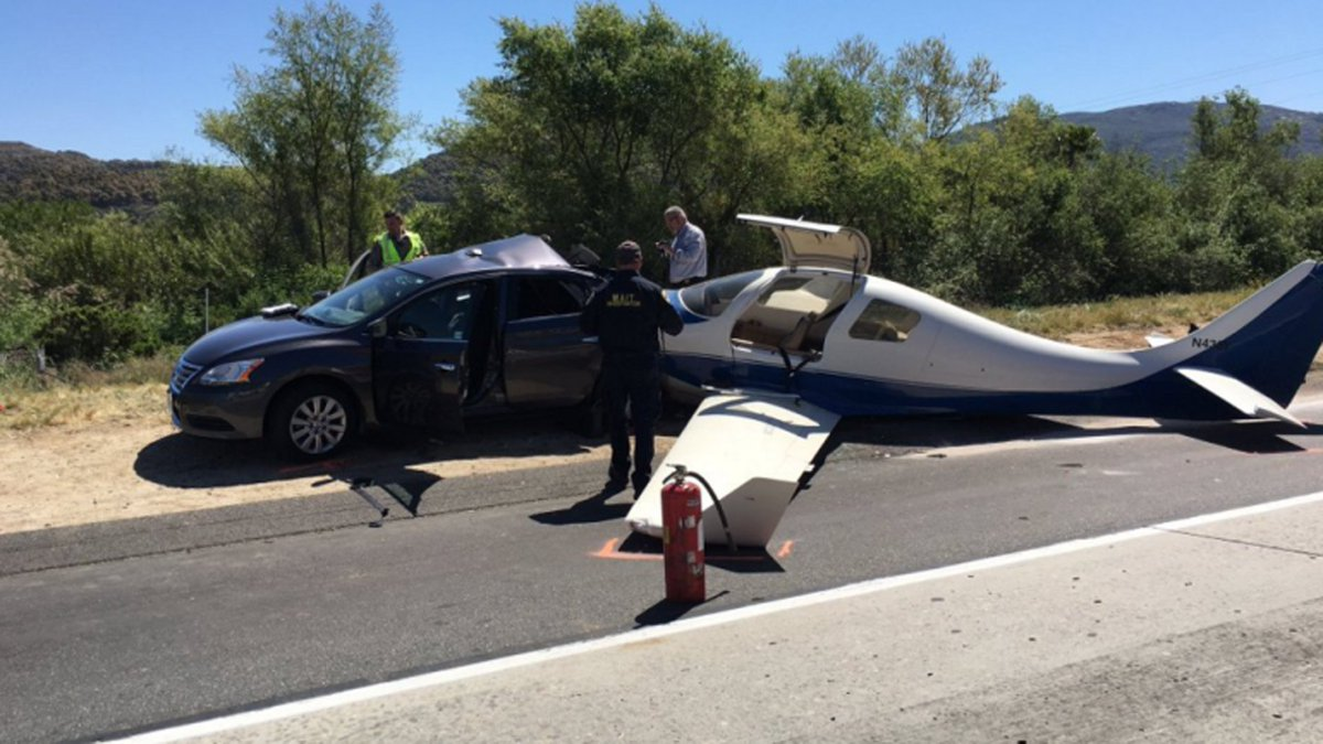 Plane lands on California interstate, killing woman in car
