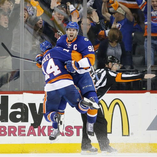 Great shot by @AP's Kathy Willens of the celebration moments after John Tavares' series-winning goal for #Isles https://t.co/SjtuPWoyta