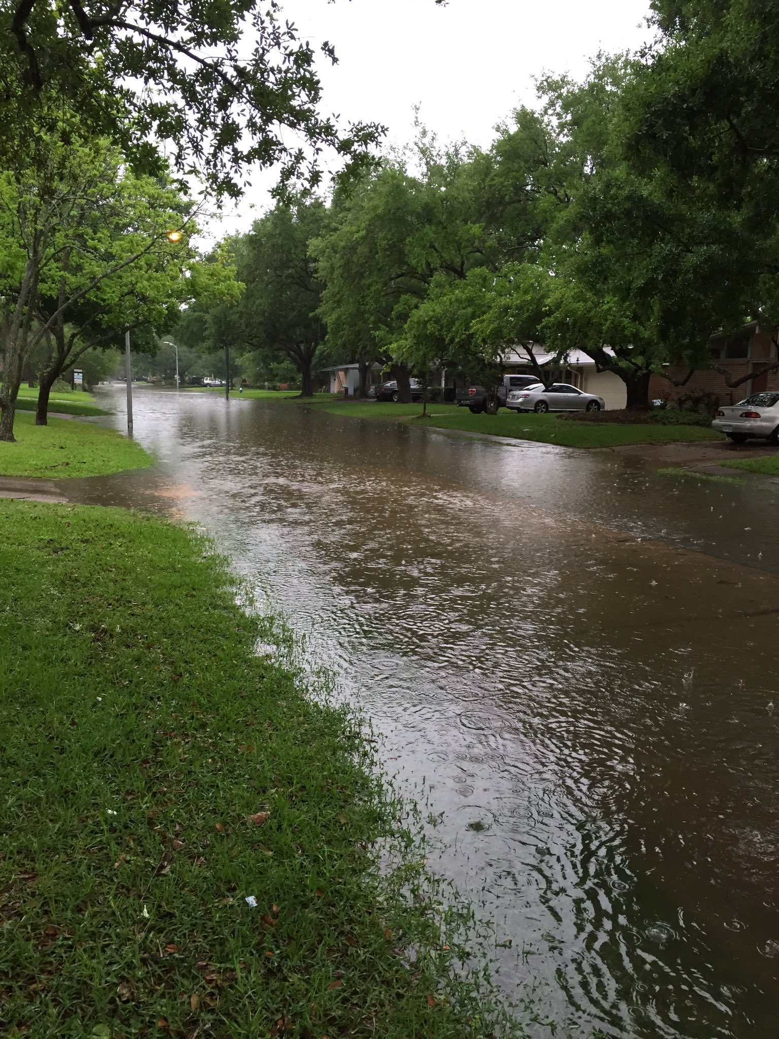 Photo: A flooded residential street in Houston ...
