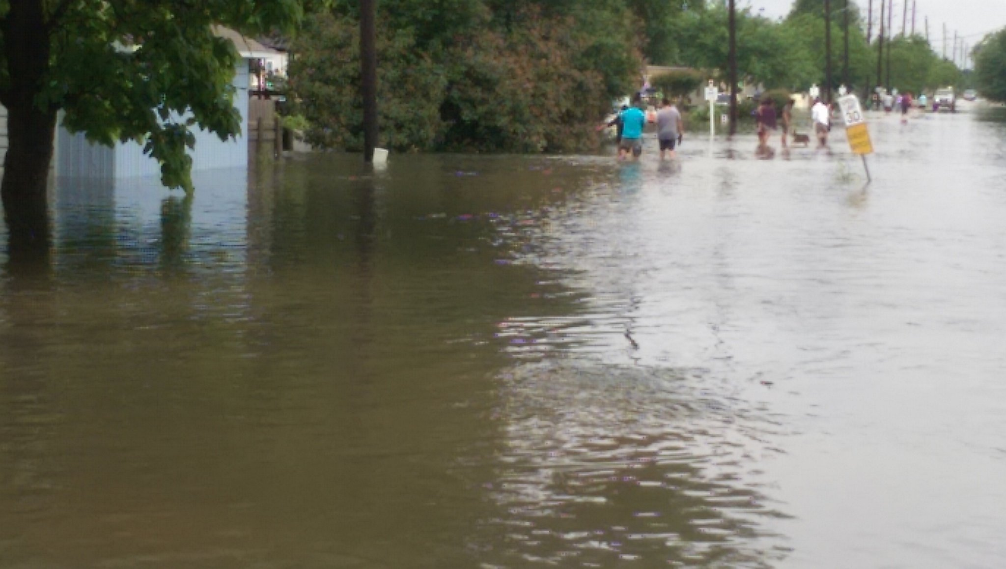 Photo: Residents walk through floodwaters in Brookshire ...