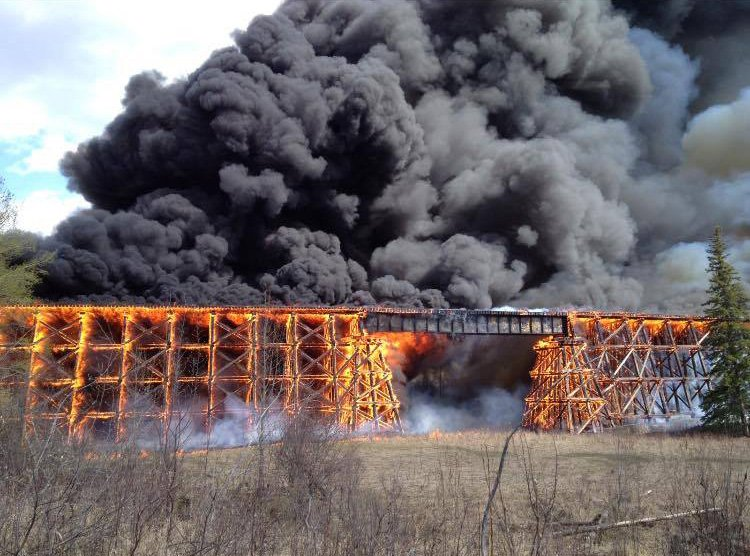 A CN trestle bridge in Mayerthorpe is in flames. @AB_EmergAlert reporting industrial fire, nearby school evacuated https://t.co/tMuvct9Das