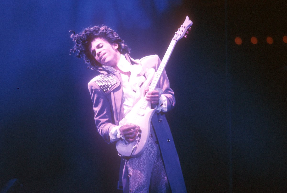 """""""Dearly beloved, we are gathered here today 2 get through this thing called life""""—Let's Go Crazy. #Prince https://t.co/Gfe1BqtFYc"""