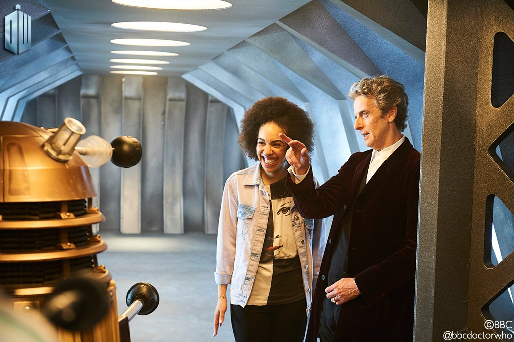 Pearl Mackie and Peter Capaldi filming a scene with a Dalek