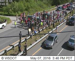 Anti-Trump protesters are blocking the highway at SR 539 and River Road near Lynden. #TrumpWA #KOMONews