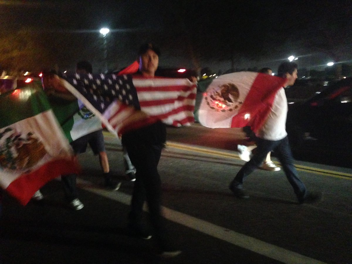 Mexican flags fly with Trump protesters in Costa Mesa