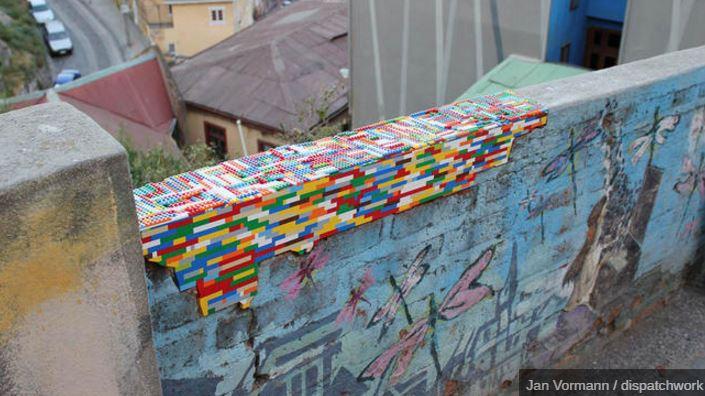 Artist uses Legos to repair buildings and walls