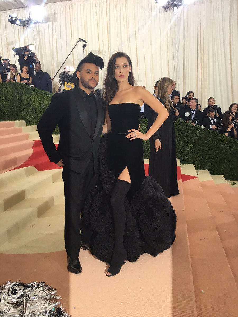Love birds @theweeknd and @bellahadid arm in arm on the #MetGala red carpet. #TheWeeknd #BellaHadid