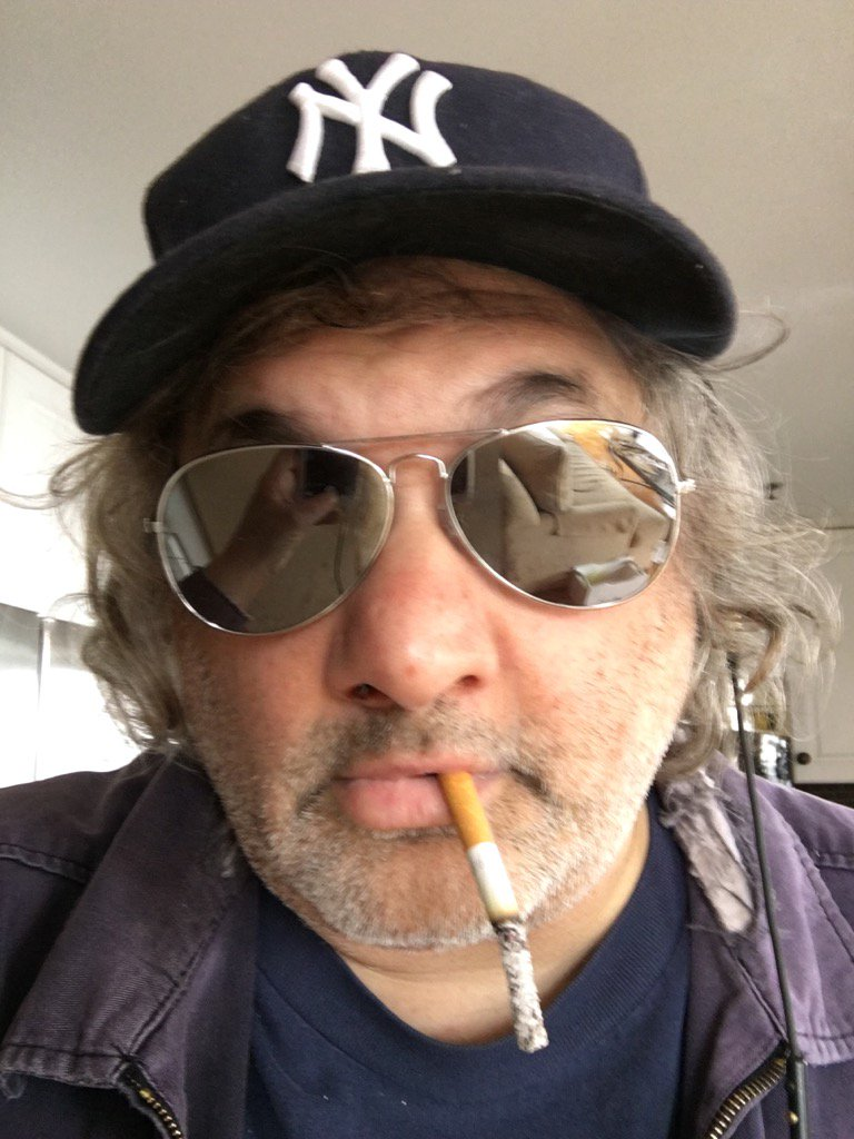 Artie Lange smoking a cigarette (or weed)