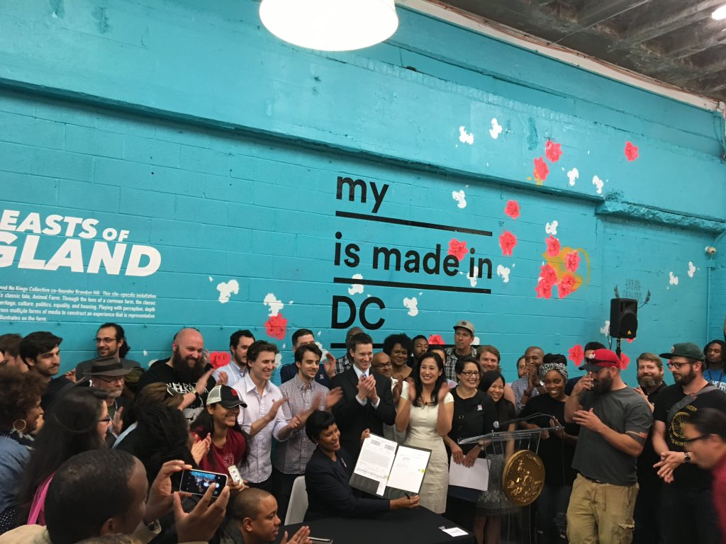 Dozens of local business owners cheer behind @MayorBowser as she signs the #MadeInDC proclamation! https://t.co/nN5fPNAX2r