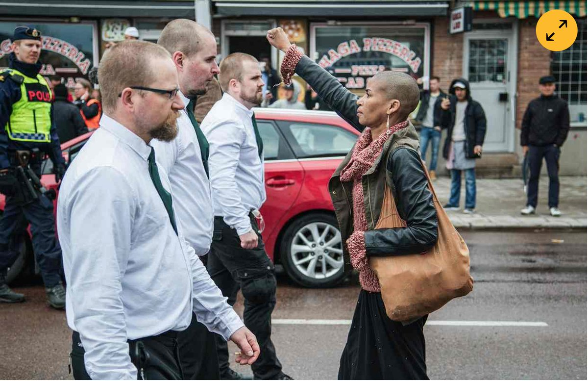 Brave Black Woman Stands Alone Against Hundreds Of Neo-Nazis