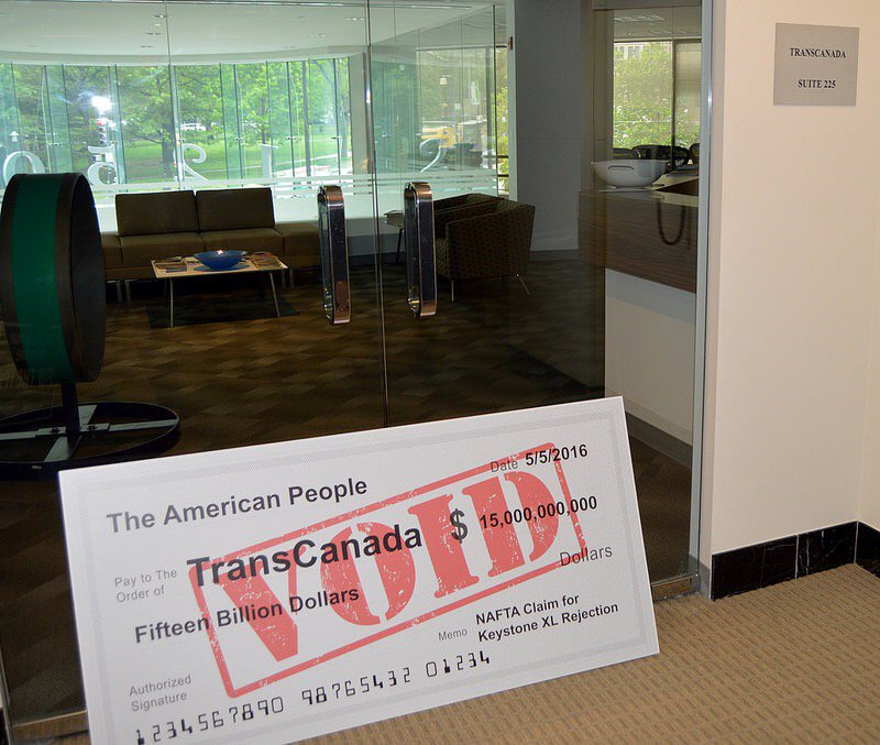 enviros deliver giant $15 billion voided check to TransCanada's DC office to protest expected NAFTA claim over KXL https://t.co/VHaMfkI33X