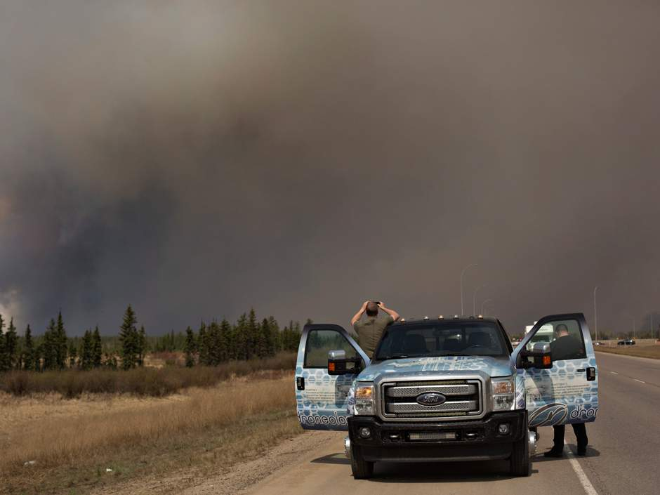 Fort McMurray fire now too large, too fierce to stop without rain FortMacFire