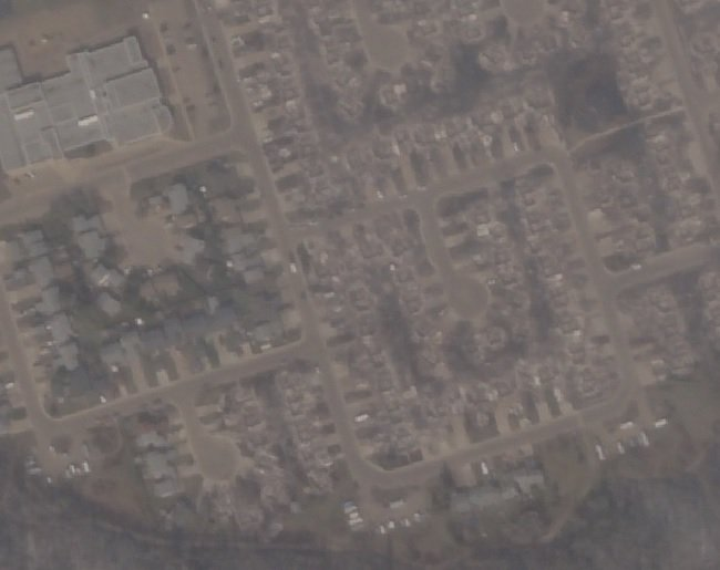 Just published satellite image of Fort McMurray showing significant fire damage #ymmfire https://t.co/EJ3rY3vFik https://t.co/yx2e8p4i5O