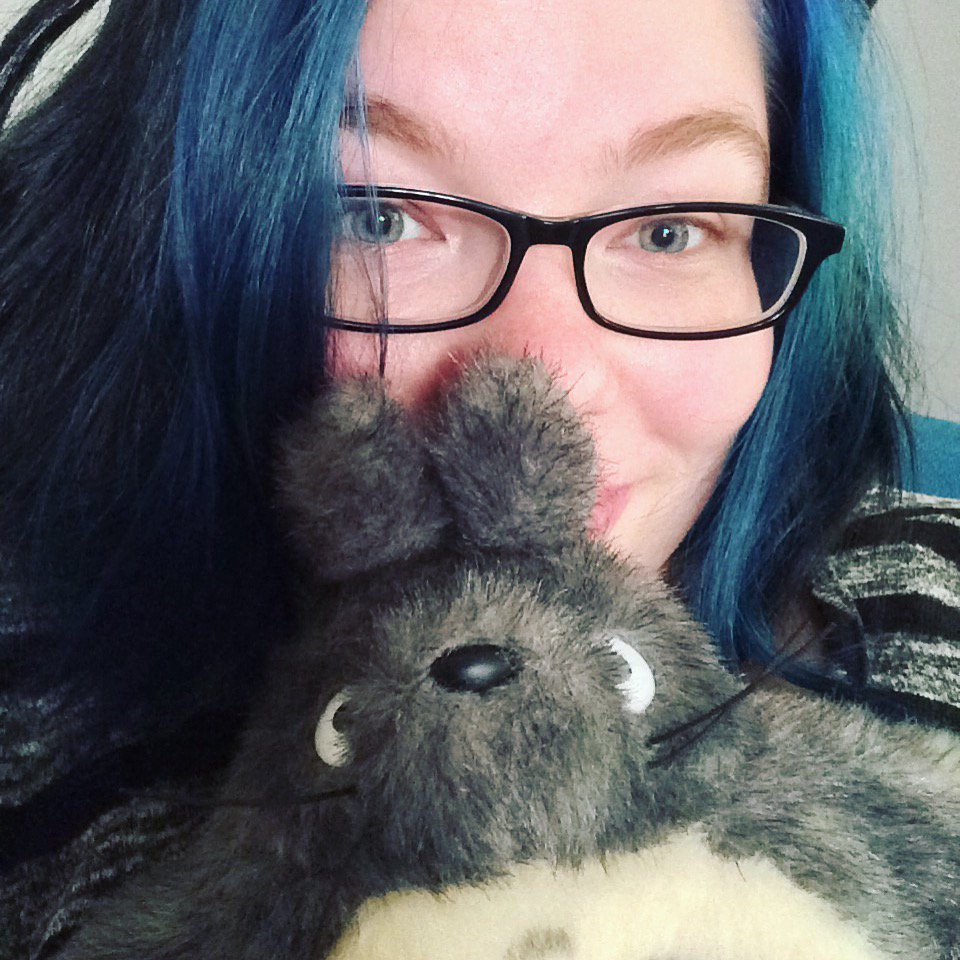 Ashe Dryden with Totoro stuffed animal