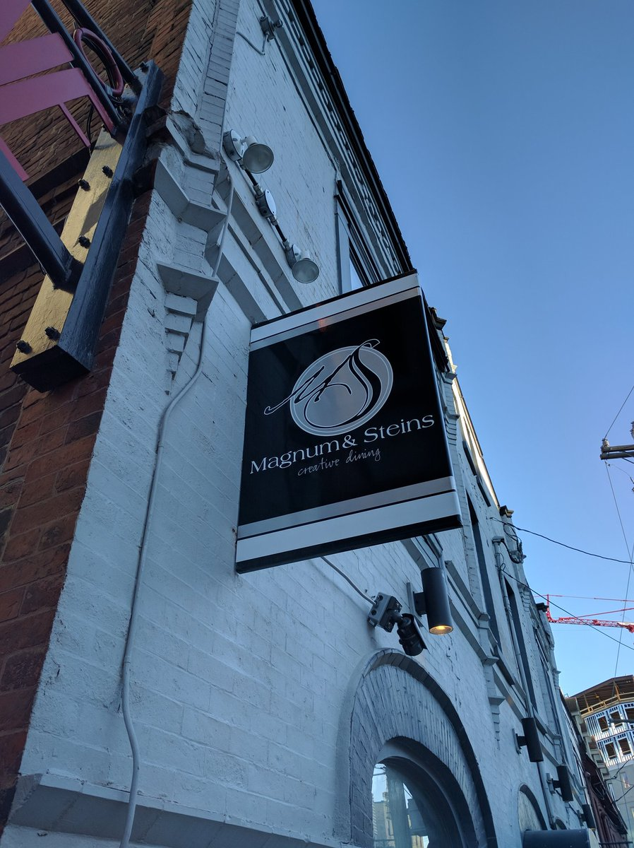 Entrance sign of Magnum and Steins at The Duckworth in St. John's, Newfoundland and Labrador