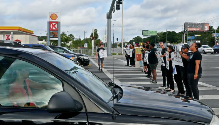 Activists block traffic to honor St. Petersburg girls who drowned in pond
