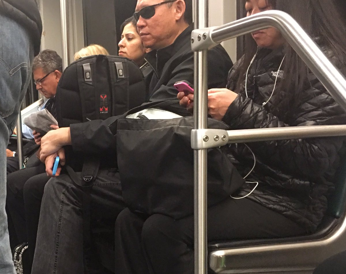 Media throwback subway people reading newspaper person