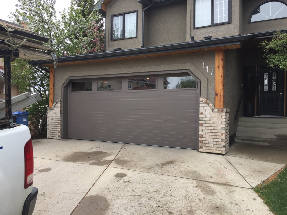 Ultra-Lite Doors on Twitter  @Clopay Modern Grooved Door in Bronze with Long Windows #yyc #ultralitedoors #garagedoorsu2026   & Ultra-Lite Doors on Twitter:
