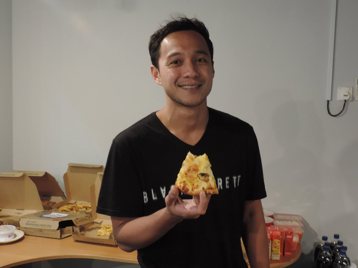 Thanks @rdzaminhat for being cool to pose with a slice of @DominosMY #CorpoRaid