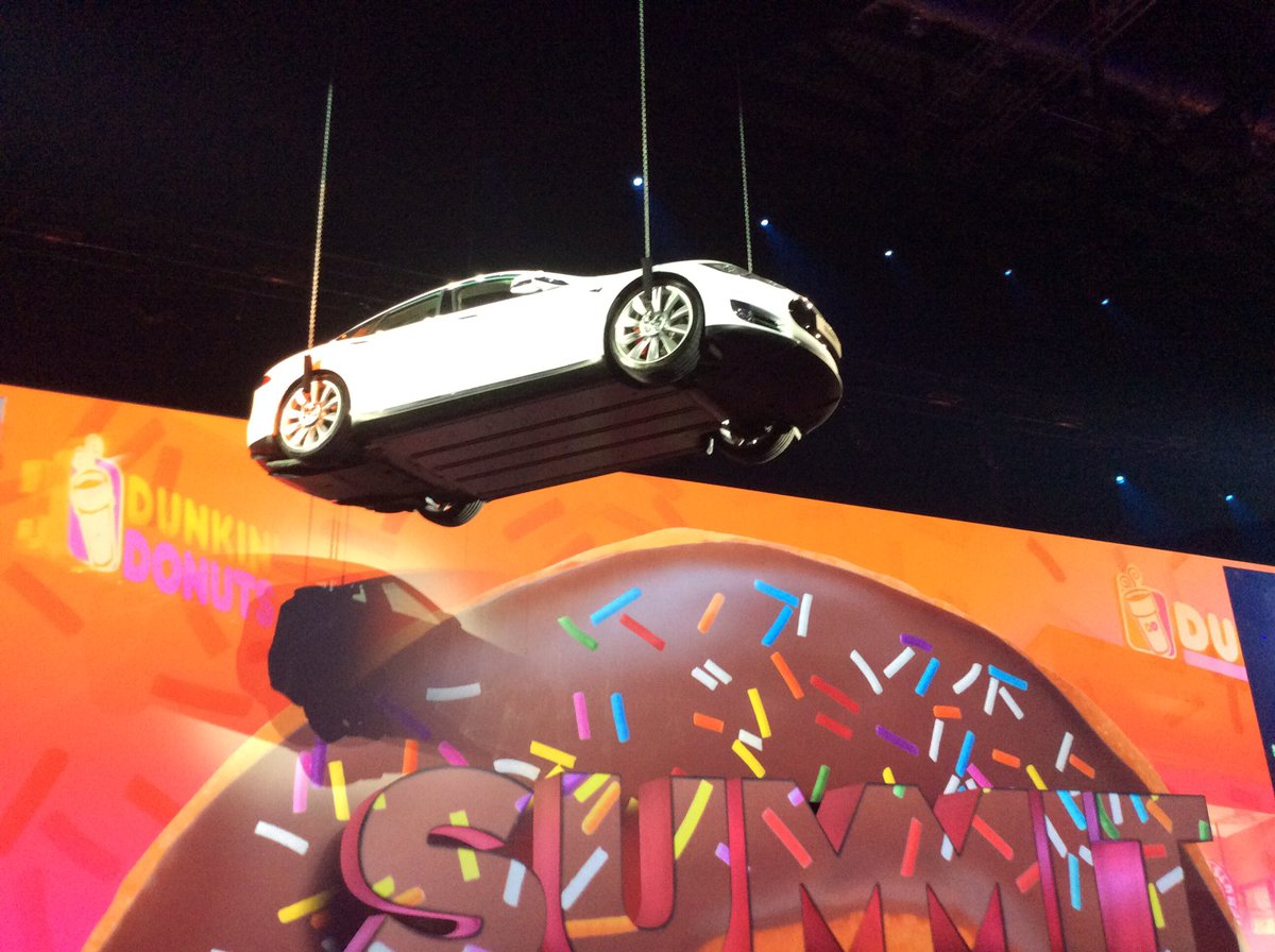 A flying @Tesla and @Dunkin Donuts--that's how we roll at #AdobeSummit https://t.co/U44wbV1rTU