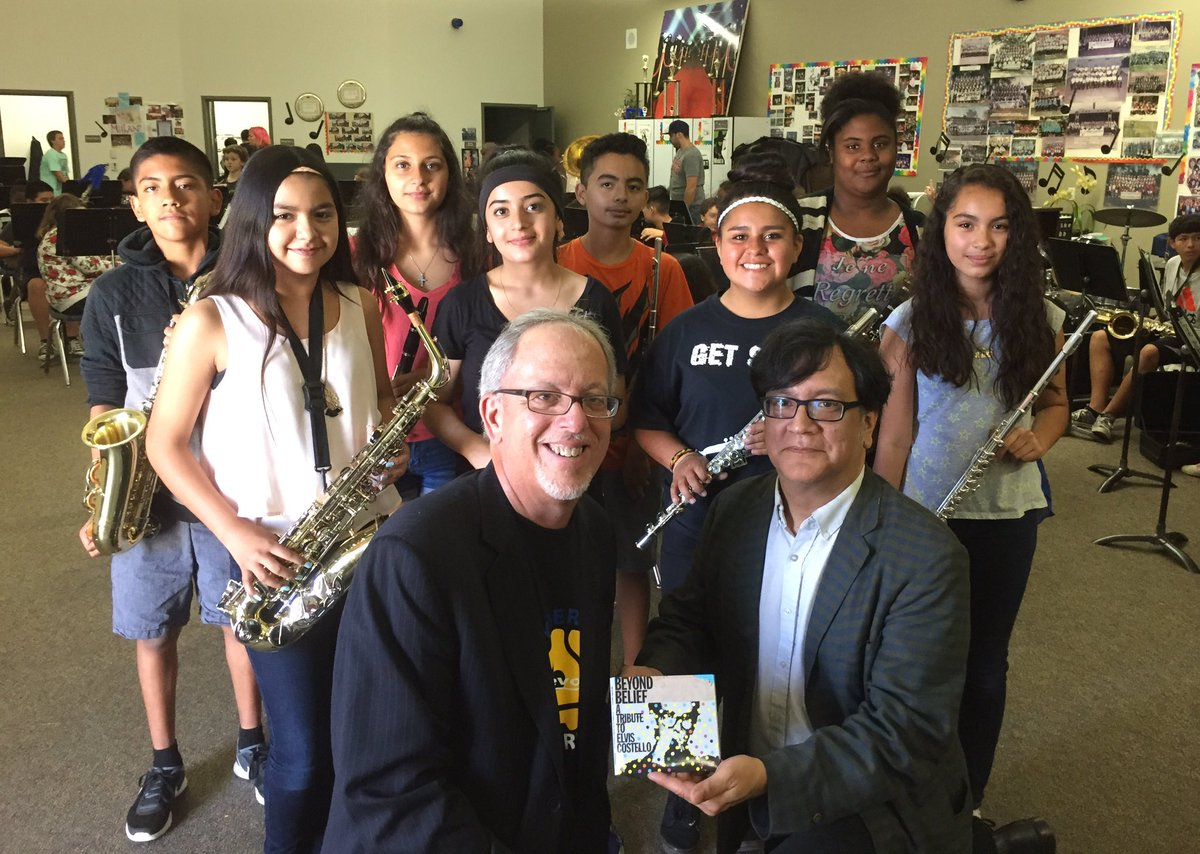 """Kids w/instruments bought with $ raised via sale of """"Beyond Belief: A Tribute to Elvis Costello"""" @HollandsOpusFdn https://t.co/OkGsyfcac8"""