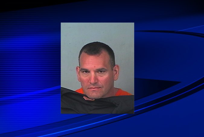 Brooksville father charged with voyeurism, child neglect