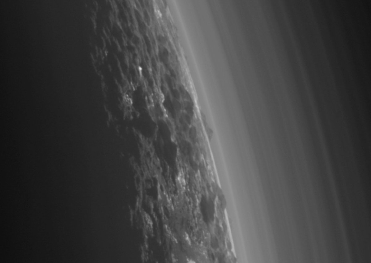 New photo of a back-lit Pluto reveals possible cloud on the dwarf planet