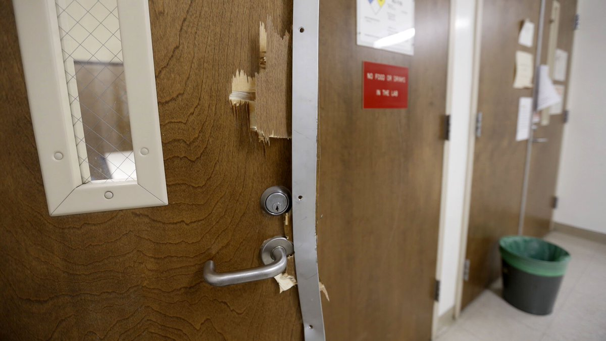 Smashed doors are seen in the UCLA engineering building near where a professor was shot and killed Wednesday. (Al Seib / Los Angeles Times)