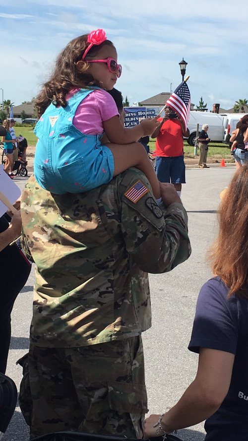 Non-profit gifts marine and his family new 'forever home'