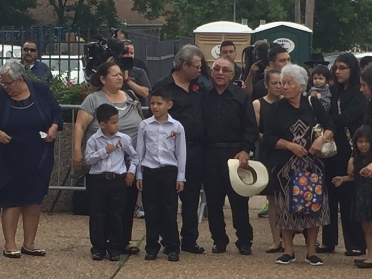 JosueFlores family waits for his casket to be unloaded. A strong resilient family. khou11