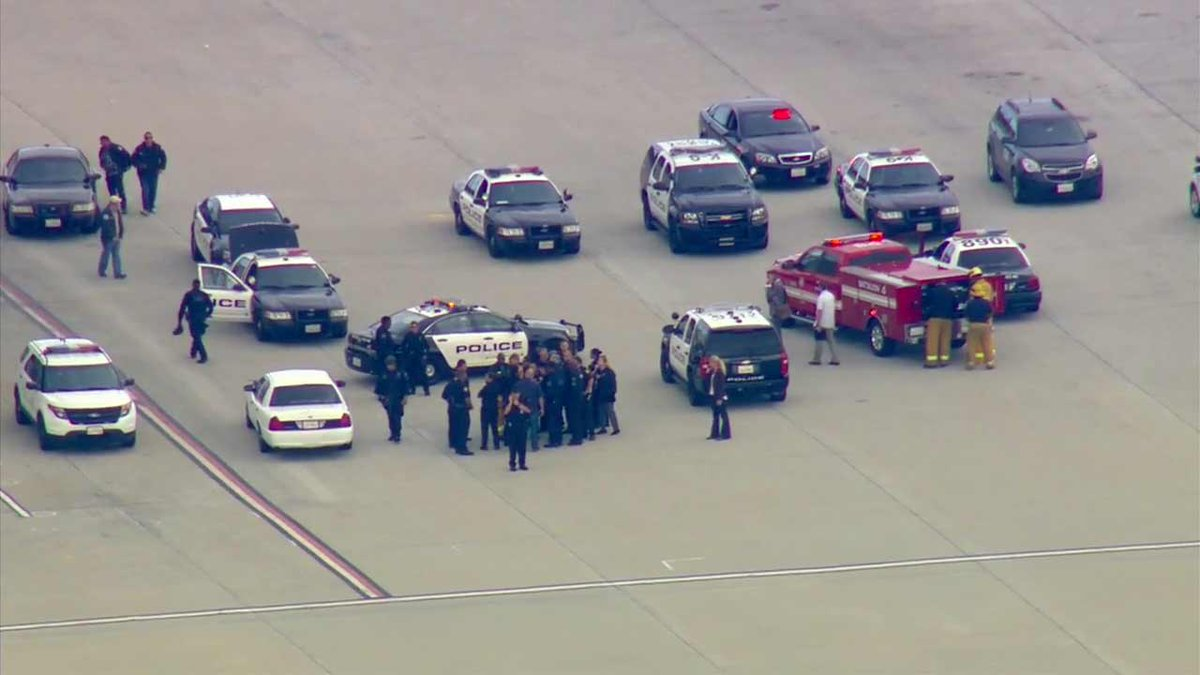 Police say FBI, bomb squad at LAX assessing possible threat on plane from Houston