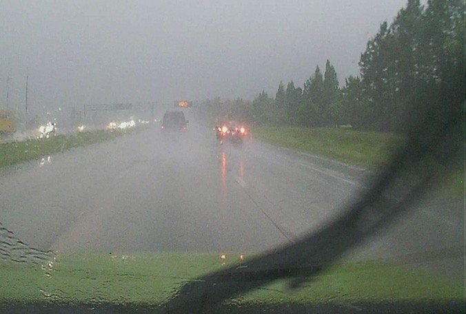 It's illegal to drive with your emergency lights on in the rain