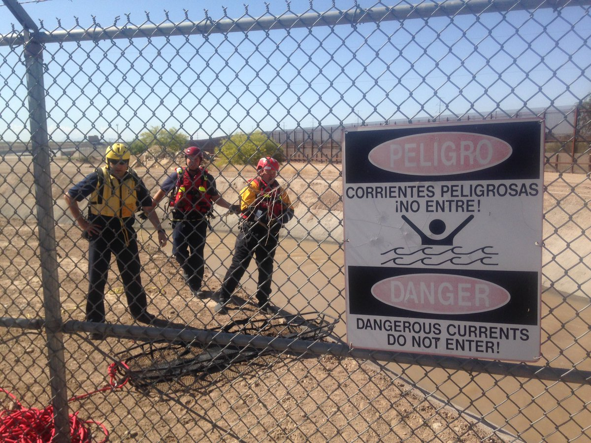 Water recovery team preparing to enter canal. Water officials will open Zaragoza head gate to release the body.