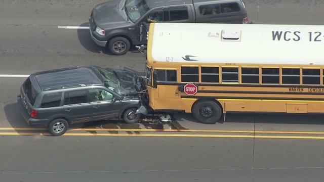 School bus, car collide head on at 15 Mile & Dequindre. 2 hospitalized, including a student