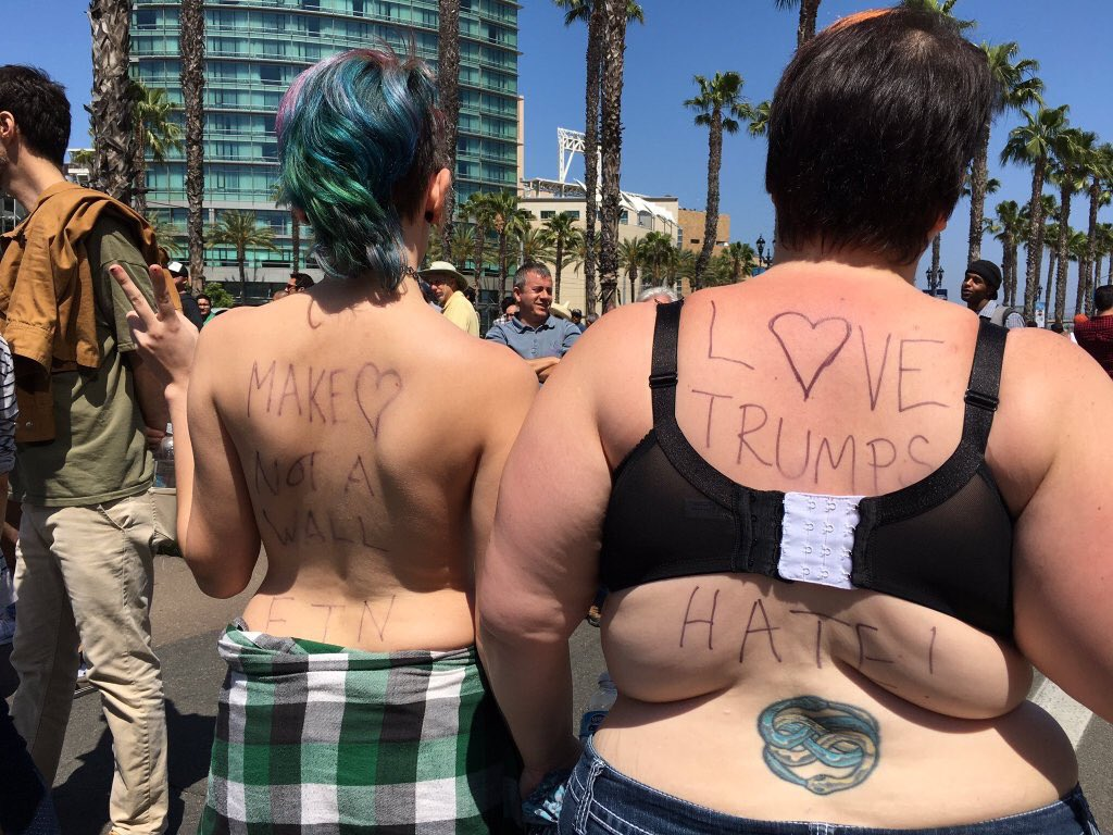 Progressives with back fat protest Trump in Fresno