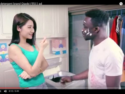Chinese detergent maker sorry for harm done by racist ad