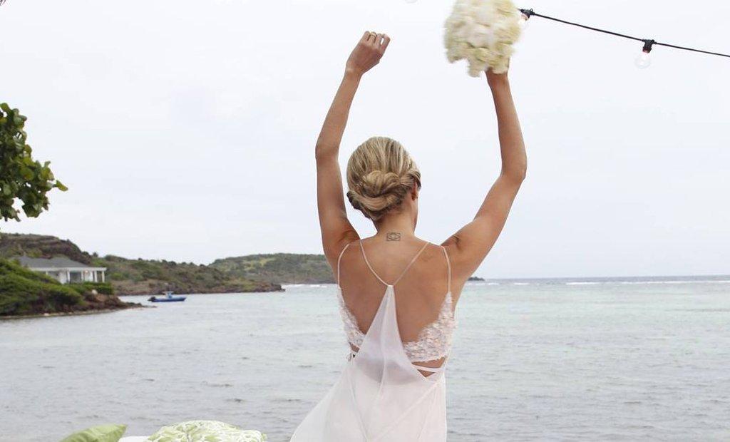 . @HelenaBordon's custom @CalvinKlein wedding gown is what fashion-girl dreams are… https://t.co/ypmWndvxvf https://t.co/RPVwUGbtJu