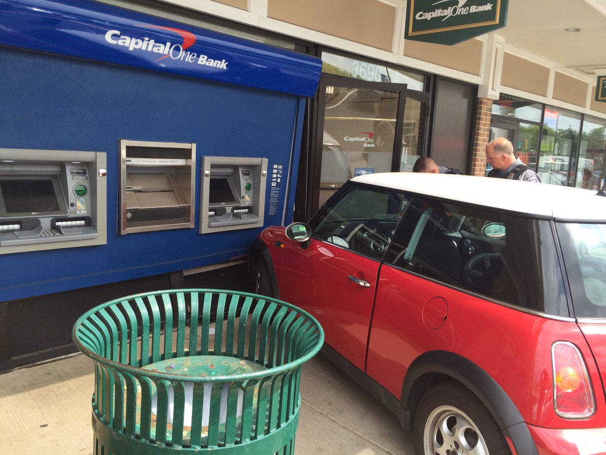Car crashes into bank at Bradlee Shopping Center in Alexandria, Virginia (Photo via @AlexFD_SOC)