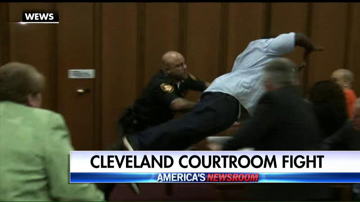 A grieving father lunged at his daughter's murderer in a Cleveland courtroom.