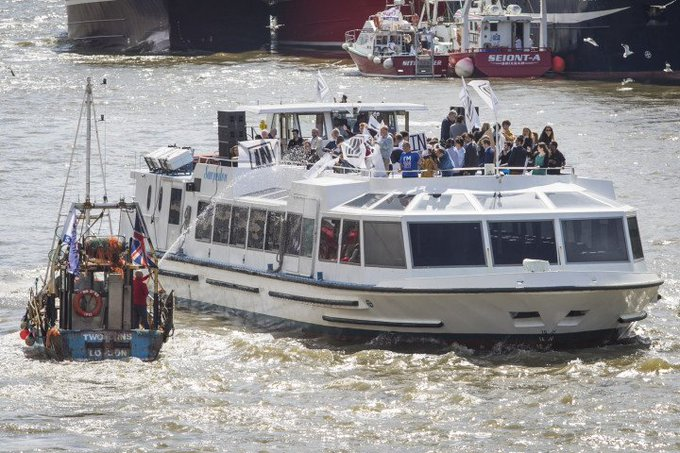 The fisherman are spraying Sir Bob Geldof and the Remain Raft with hoses: