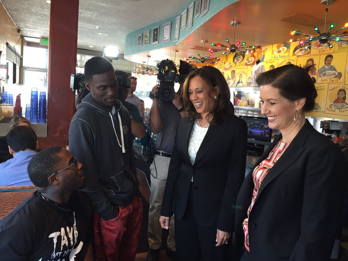 U.S. Senate candidate Kamala Harris, center, and Oakland Mayor Libby Schaaf chat with diners at the Home of Chicken and Waffles. (Phil Willon / Los Angeles Times)