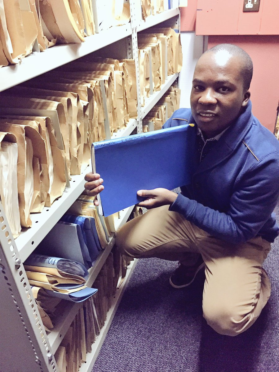 .@sabcinfolib librarian, @justiceleshilo with a Music Festival news clippings file - for #IAD16 #@ArchivesRock https://t.co/hmY3dbdA0C