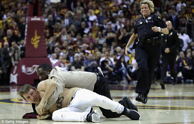 ee1429d90304f shirtless fan with trump sucks on chest tackled on court at nba finals