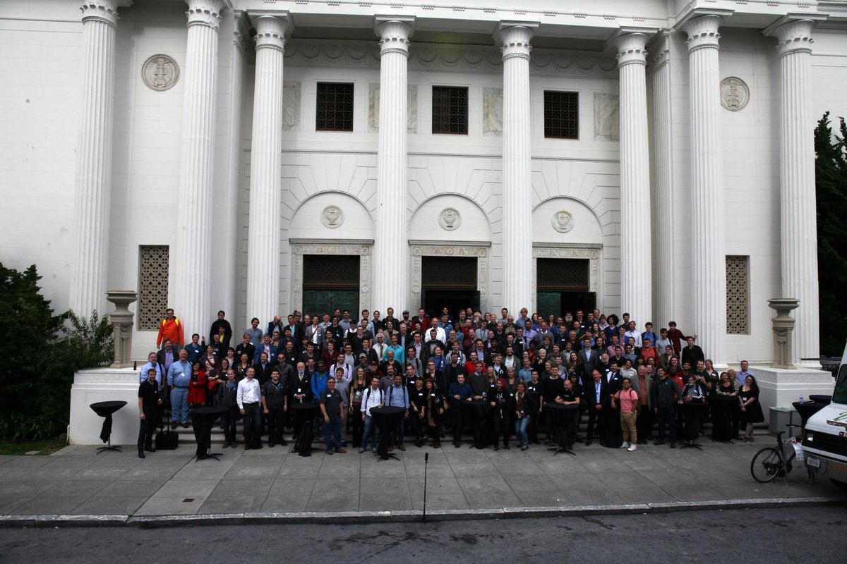 Group photo of Decentralized Web Summit attendees in front of the Internet Archive building.