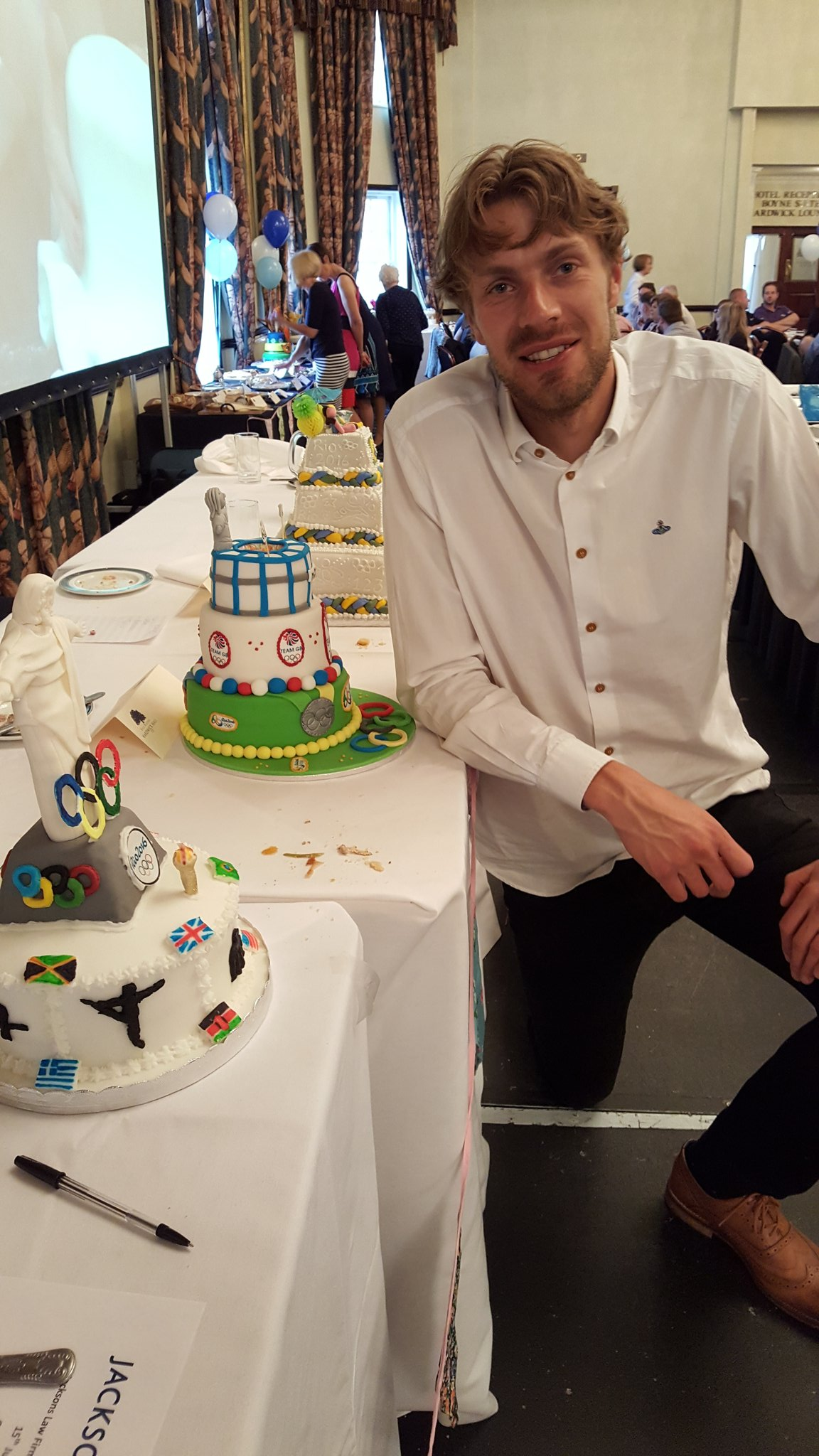 Chris Tomlinson with the line up of cakes. Photo Source: Twitter @Jacsfirth